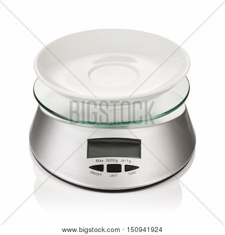 Concept image with kitchen scale illustrating the concept of strict diet and measuring of food portions intake.