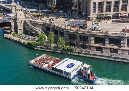 Chicago, USA - May 30, 2016: Aerial view of Lake Michigan and Wacker Drive with large boat ship on downtown river