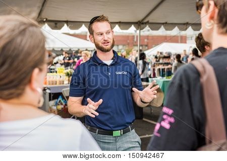 Washington DC, USA - September 24, 2016: SolarCity salesman representative at VegFest festival
