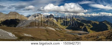 Panorama of Caucasus mountains. Mount Urup, mount Sedaya and rock Zagedan and mount Shhuanta in the upper reaches of the river Zagedanki, a tributary of the Big Laba. Karachay-Cherkessia. Russia.