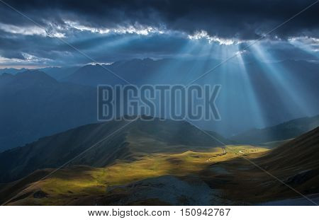 Mountain valley in beams of evening sun. View of Greater Caucasus Mountain Range from a mount Zagedan slope. Caucasus mountains. Karachay-Cherkessia. Russia.