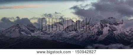 Morning twilight from the top of Greater Caucasus Mountain Range. Caucasus mountains. Karachay-Cherkessia. Russia.