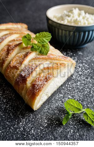 Curd Strudel With Raisins And Sprinkled With Icing Sugar