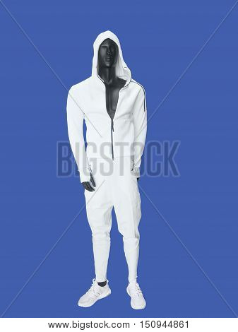 Male mannequin wearing clothes for sport over blue background