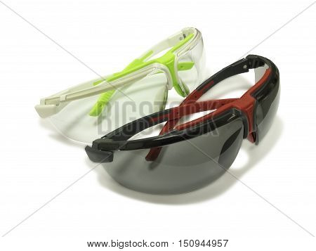 Two safety glasses isolated on white background.