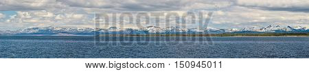Panorama of snowcapped mountains with lake in Yellowstone national park