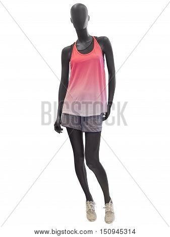 Female mannequin dressed in shorts and tank top isolated on white background. No brand names or copyright objects.