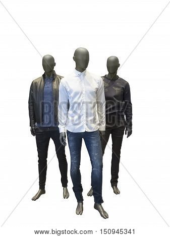 Three full length male mannequins dressed in casual clothes isolated on white background. No brand names or copyright objects.