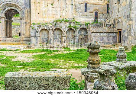 The Funeral Chapel of St Gregory with the stone decors of Gavazan Siun Pillar on the foreground Tatev Monastery Syunik Province Armenia.