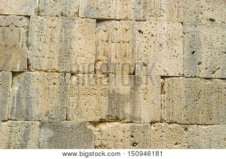 The old wall of St Peter and Paul Cathedral with preserved medieval carvings of the cross-stones (khachkars) Tatev Monastery Syunik Province Armenia.