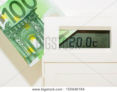 Concept thermostat and banknote for heating expensive