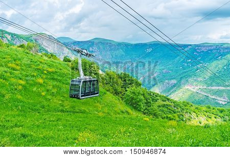 The tram of Wings of Tatev cableway is arriving to the Upper station located at Tatev Monastery Syunik Province Armenia.