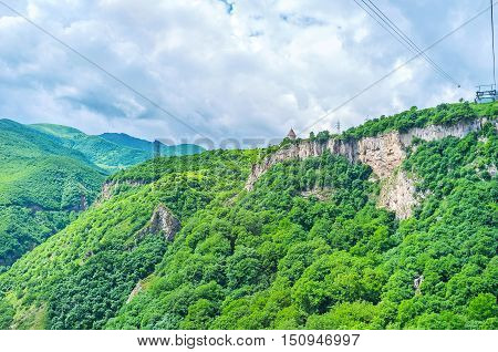 The Tatev Monastery and Wings of Tatev cableway station located on the steep mountain at the Vorotan canyon Syunik Province Armenia.