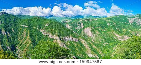 Panorama of the rocky moutains covered with greenery is seen from the in Halidzor village Syunik Province Armenia.