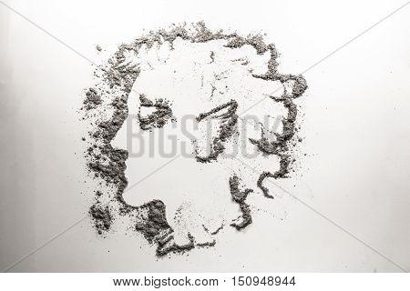 Myth man head drawing in grey ash dust sand dirt