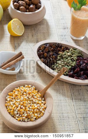 Table With Dry Fruits And Various Seeds