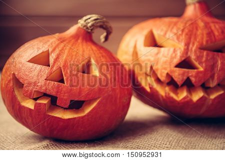 Halloween pumpkins rustic background for autumn holidays