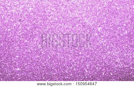 Vibrant pink purple sparkle background.  Abstract shimmer and glitter textured background.  Graphic resource with twinkle and shine.