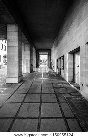 Stone hallway angle shot with tiled floor