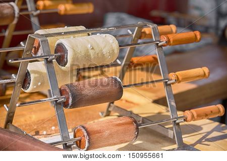 Manufactory - production of sweet dough which is rolled out in strips, and then is wound onto beech roller and baked in the heat of the charcoal. Popular in the Center and Northern Europe