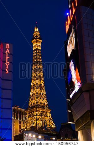 Las Vegas USA - May 13 2006: Eifel Tower replica at Paris Las Vegas hotel and casino and other buildings on the Strip