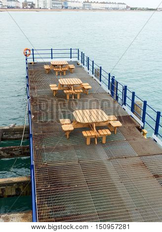 Deserted Seats And Tables On Pier In Eastbourne Uk