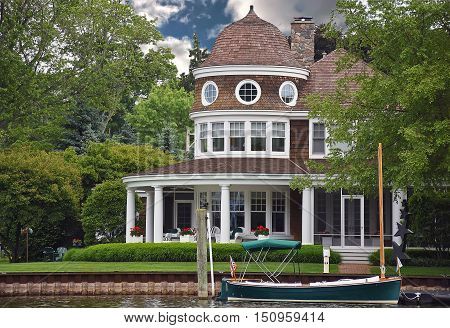 luxury summer home on the river with boat