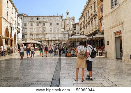 SPLIT, CROATIA - SEPTEMBER 11, 2016: People's Square is the central square of Split built in the times of the early Middle Ages located to the west of the Diocletian's Palace.