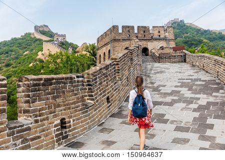 Great Wall of China. Tourist on Asia travel walking on famous Chinese tourist destination and attraction in Badaling north of Beijing. Woman traveler hiking great wall enjoying her summer vacation.