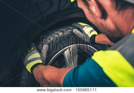 Tire and Wheel Service. Men Preparing Equipment For a Tire Service.