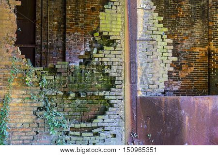 Crumbling Brick Wall of the former Power Plant at the Central Indiana Hospital for the Insane built in 1886 and abandoned in the 1970s IV