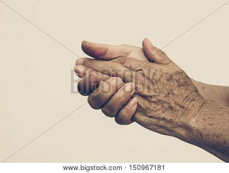 hands of a female elderly in old vintage tone