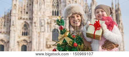 Mother And Child Tourists With Christmas Tree And Gift In Milan