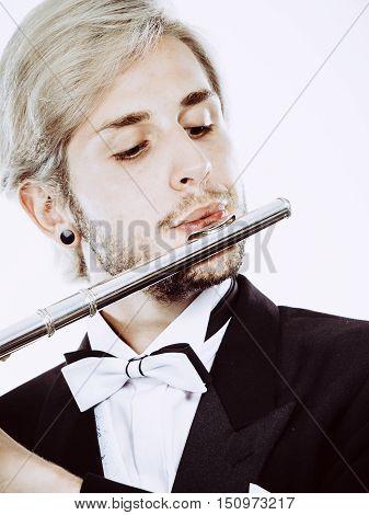 Male Flutist Wearing Tailcoat Plays Flute