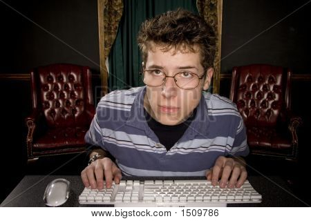 Teenage Boy Studying On Comptuer