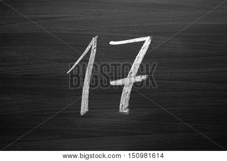 number seventeen enumeration written with a chalk on the blackboard