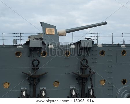 Saint Petersburg Russia September 08 2016: Anchor and bow gun of the cruiser Aurora in St. Petersburg Russia.