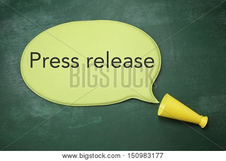 bullhorn with speech bubble written press release