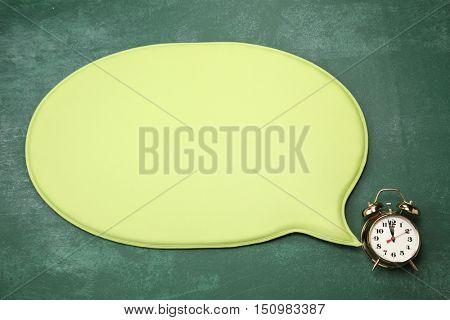 alarm clock with speech bubble
