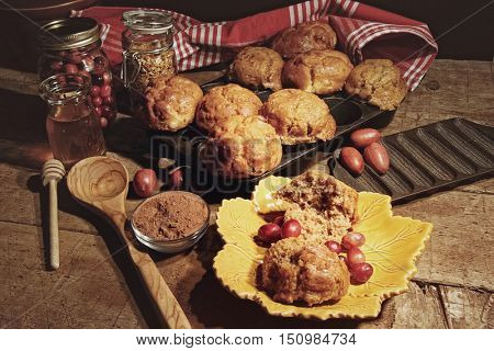 Cranberry muffins with fresh berries on table