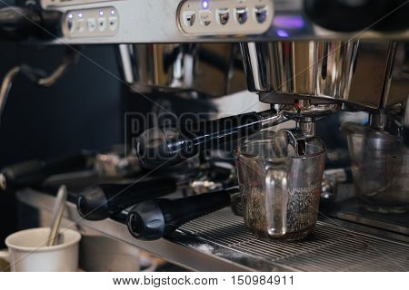 Coffee machine preparing fresh coffee at cafe.Vintage style process.
