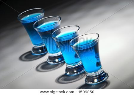 Four Blue Drink In 4 Glasses