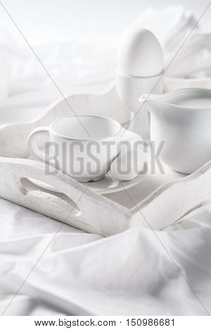 Still life for breakfast in bed captured in low key format. White on white.