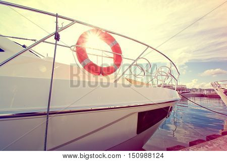 Lifebuoy on the yacht at summer day. Vintage retro picture.