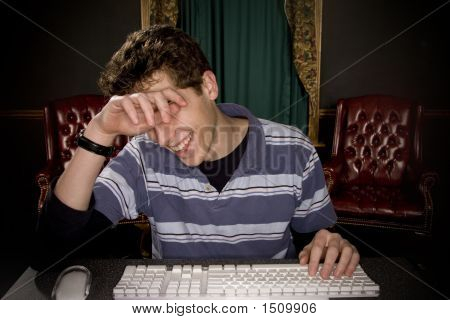 Teenage Boy Enjoying Computer