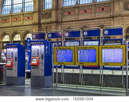 Zurich, Switzerland - 9 October, 2016: ticket automates and departure boards in the hall of Zurich main railway station. Zurich main railway station is the largest railway station in Switzerland and one of the busiest railway stations in the world.