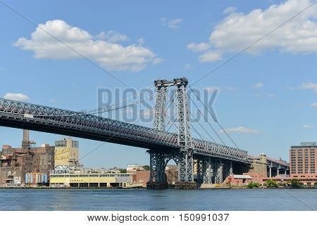 New York City - Sept 15, 2012: View of the Manhattan Bridge as seen from the East Side of Manhattan New York. Includes the abandoned Domino Sugar plant.