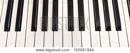 A photo of piano keys, shot from above
