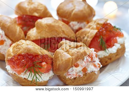 Profiteroles with salmon, red caviar and cheese cream