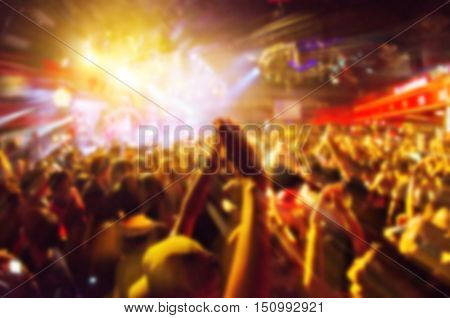 blur concert in club party.hands clapping,concert in clubs that have Music fun. Blurry night club concert party people enjoy of music dancing sound .